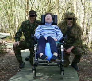 Two members of 34 Sqn with sanctuary owner Rosie