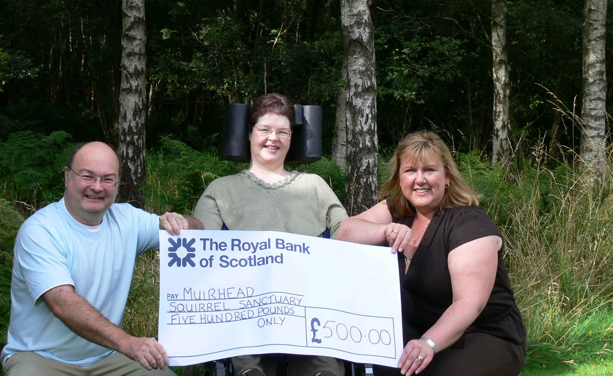 Jimmie & Rosie receiving a cheque from Anne Smith